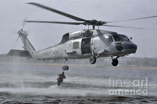 A Search And Rescue Swimmer Jumps Print by Stocktrek Images