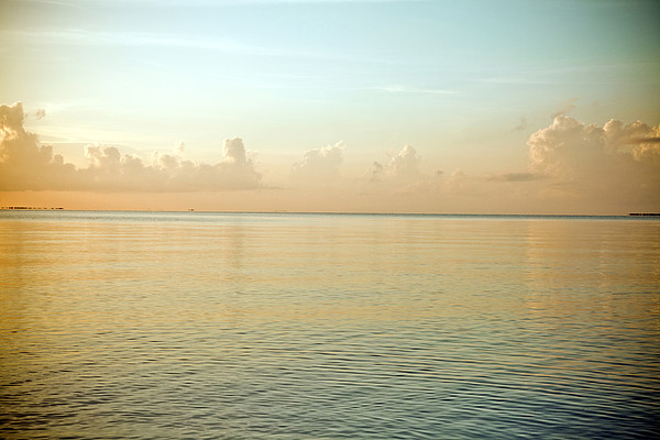 A Serene Landscape Of The Ocean And Sky At Sunrise Print by Adam Hester