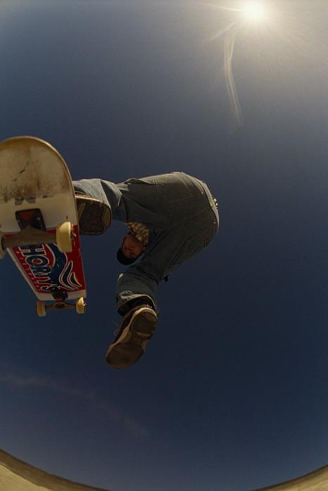 A Skateboarder Jumping At A Skate Park Print by Bill Hatcher