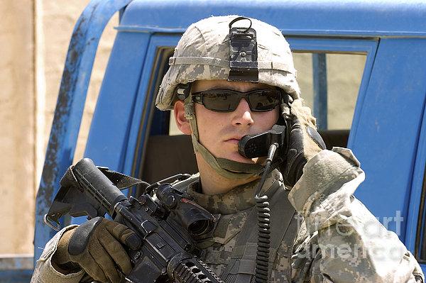 A Soldier Talking Via Radio Print by Stocktrek Images
