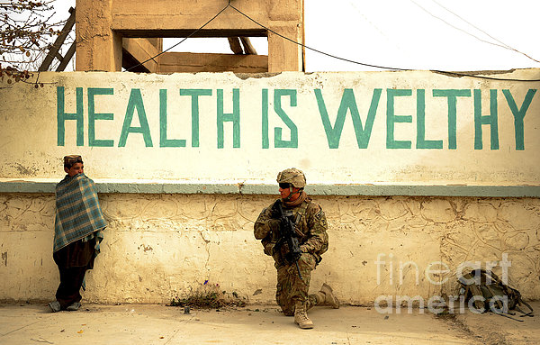A Soldier Talks To An Afghan Boy Print by Stocktrek Images