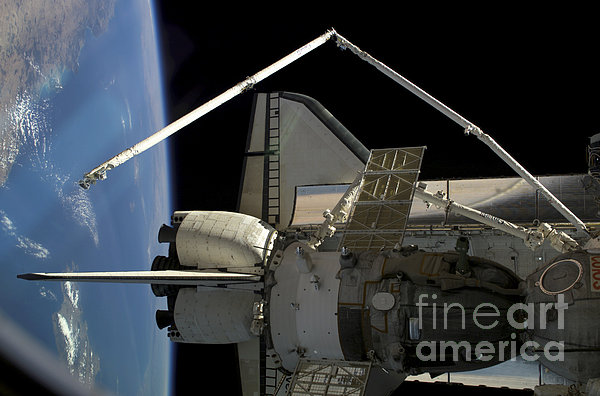 A Soyuz Vehicle And The Space Shuttle Print by Stocktrek Images