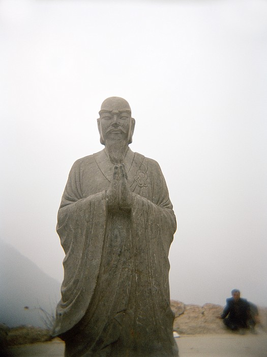 A Statue Of A Buddhist Monk In China Print by Justin Guariglia
