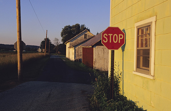 A Stop Sign In A Rural Alley Print by Raymond Gehman