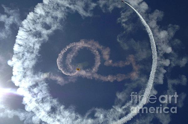A Stunt Plane Flies Print by Stocktrek Images
