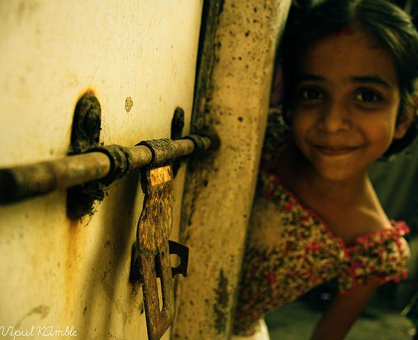 A Sweet Smile Beyond Door Print by Vipul Kamble