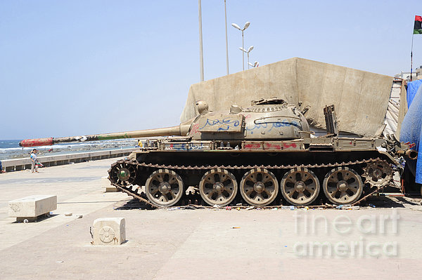 A T-55 Tank On The Seafront Print by Andrew Chittock