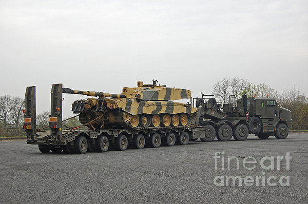 A Tank Transporter Hauling A Challenger Print by Andrew Chittock