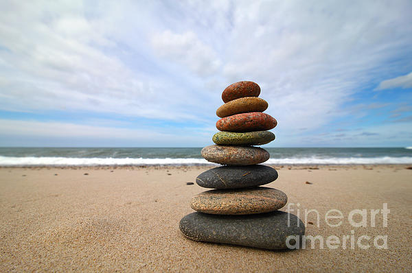 A Tower Of Stones On The Beach Print by Holger Ostwald