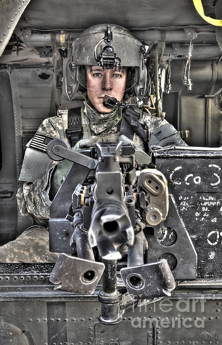 A Uh-60 Black Hawk Door Gunner Manning Print by Terry Moore