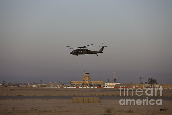 A Uh-60 Blackhawk Helicopter Flies Print by Terry Moore