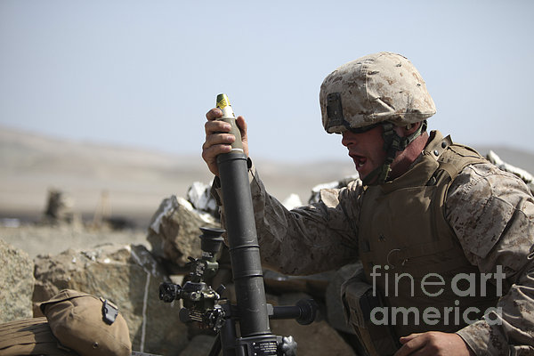 A U.s. Marine Loads A Mortar Print by Stocktrek Images