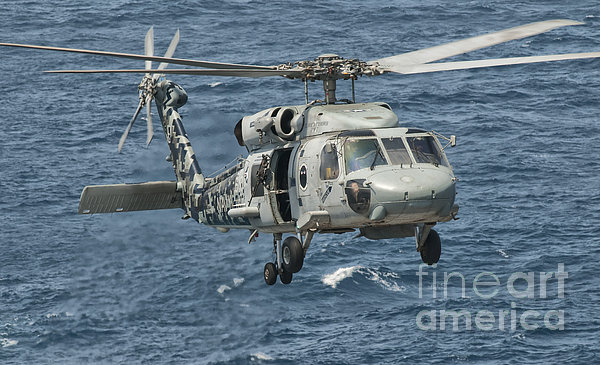 A Us Navy Sh-60f Seahawk Flying Print by Giovanni Colla
