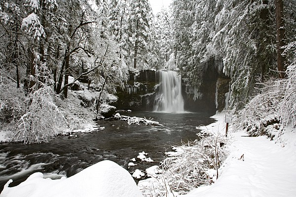 A Waterfall In To A River In Winter Print by Craig Tuttle