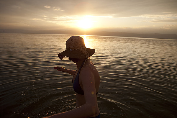 A Woman Wades Into The Dead Sea Print by Taylor S. Kennedy
