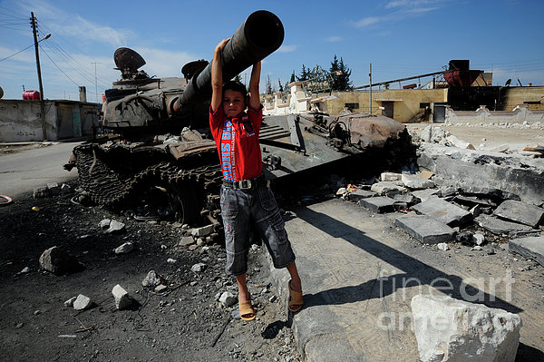 A Young Syrian Boy Plays On The Turret Print by Andrew Chittock