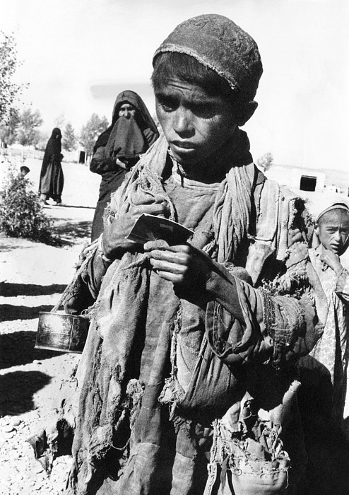 Afghan Youngster In A Unicef Feeding Print by Everett