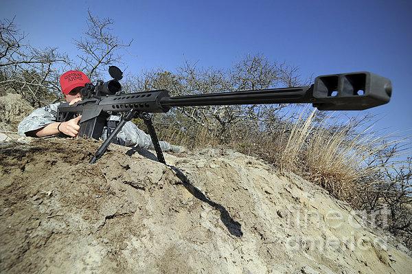 Airman Sights A .50 Caliber Sniper Print by Stocktrek Images