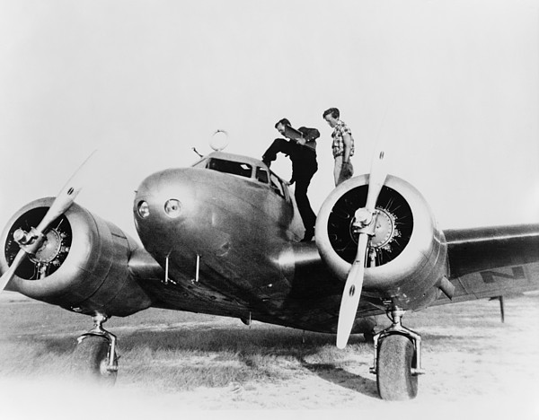 Amelia Earhart Stanind On The Wing Print by Everett