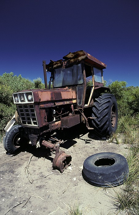 An Abandoned Tractor Rusts Away Print by Jason Edwards