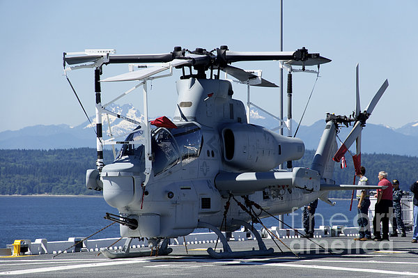 An Ah-1w Cobra Is Chained To The Flight Print by Stocktrek Images