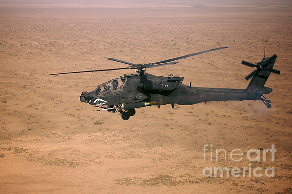 An Ah-64d Apache Longbow Fires A Hydra Print by Terry Moore