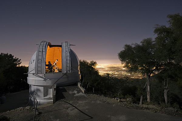 An Astronomer Works Inside A Dome Print by Jim Richardson