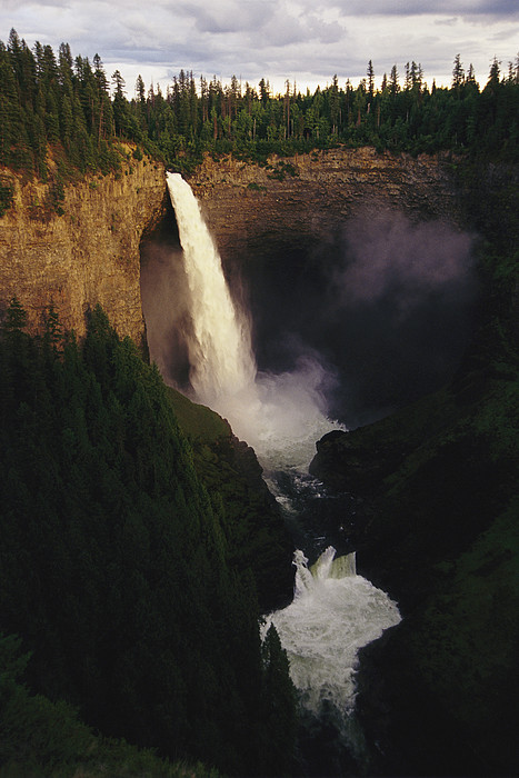 An Elevated View Of Helmcken Falls Print by Raymond Gehman