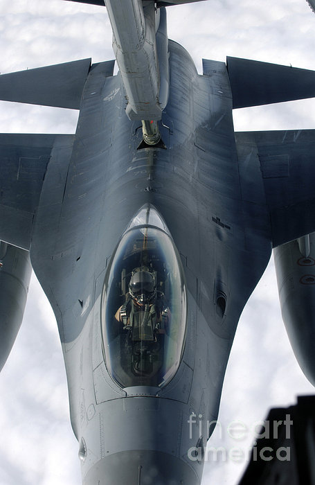 An F-16 Fighting Falcon Receives Fuel Print by Stocktrek Images