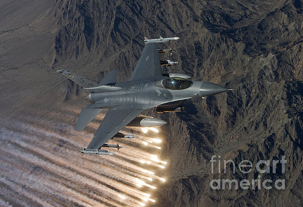 An F-16 Fighting Falcon Releases Flares Print by HIGH-G Productions