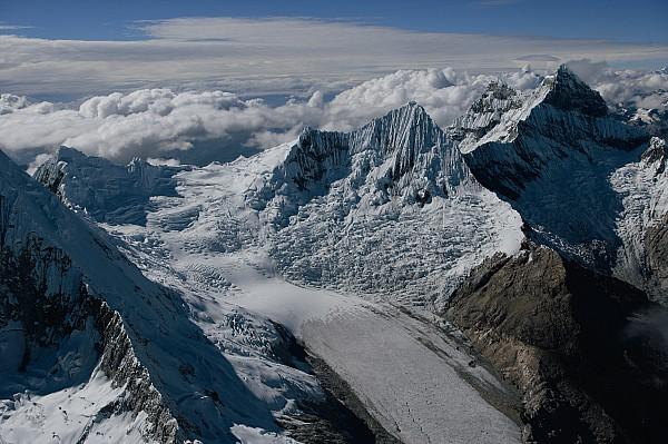 An Icy Ravine Between Glacial Peaks Print by Bobby Haas