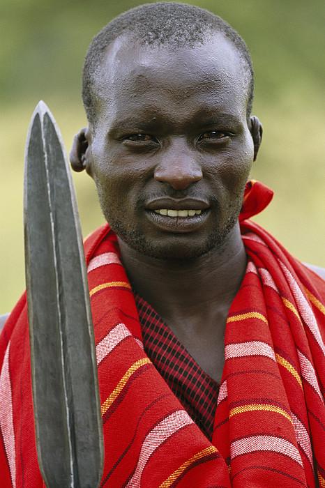 An Informal Portrait Of A Masai Warrior Print by Michael Melford