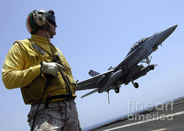 An Officer Observes An Fa-18f Super Print by Stocktrek Images