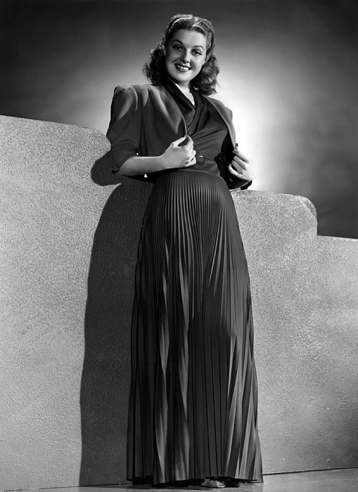 Ann Sheridan Wearing Pleated Evening Print by Everett