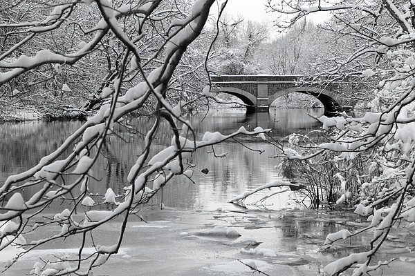 Arch Bridge Over Frozen River In Winter Print by Enzo Figueres