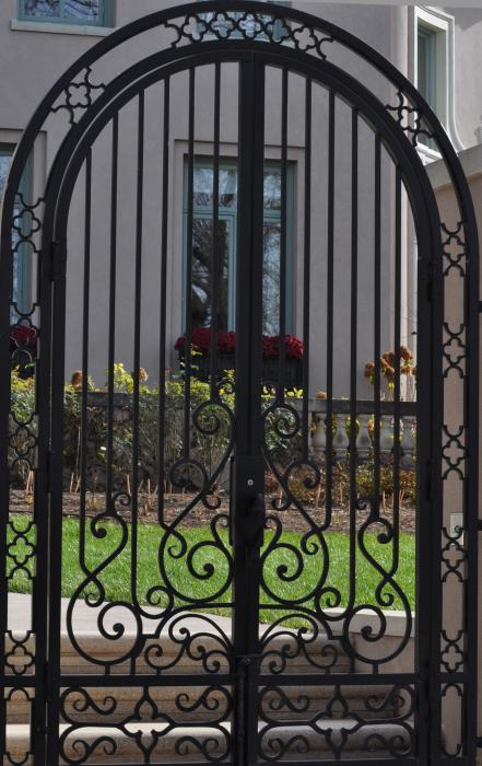 Arched iron gate by diana nigon