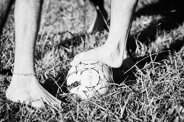 Argentinian Hispanic Men Start A Football Game Barefoot In The Park On Grass Print by Joe Fox