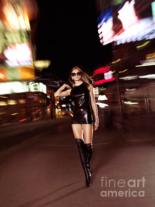 Attractive Young Woman Walking Down The Street At Night Print by Oleksiy Maksymenko