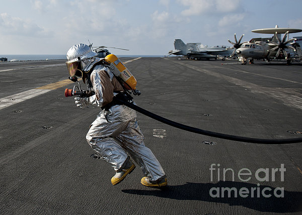 Aviation Boatswain's Mate Carries Print by Stocktrek Images