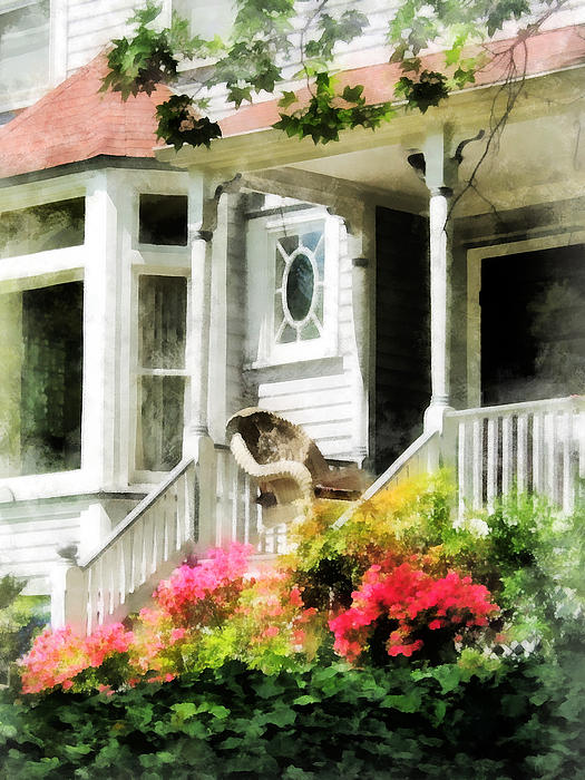 Azaleas By Porch With Wicker Chair Print by Susan Savad