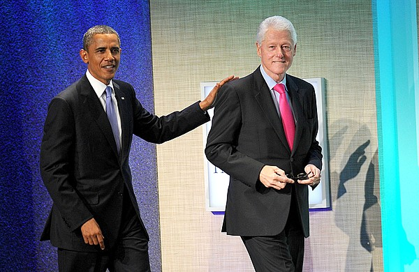 Barack Obama, Bill Clinton At A Public Print by Everett