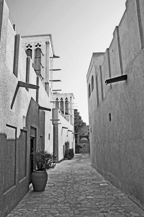 Black And Whitetraditional Middle Eastern Street In Dubai Print by Chris Smith