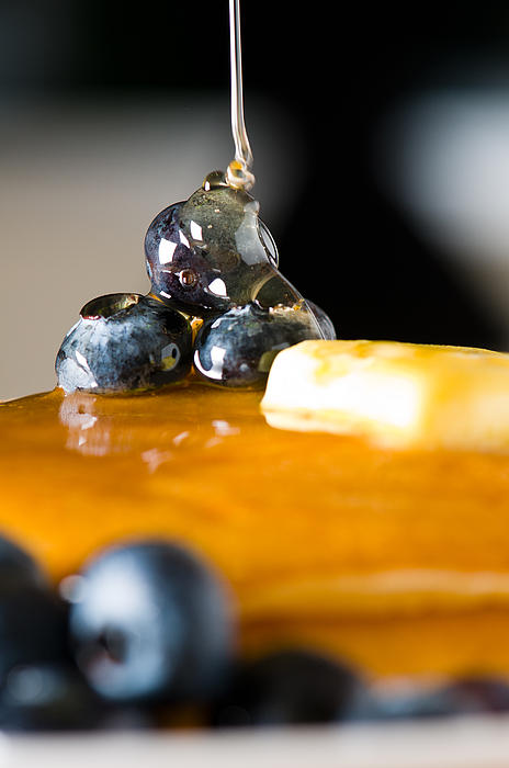 Blueberry Butter Pancake With Honey Maple Sirup Flowing Down Print by Ulrich Schade
