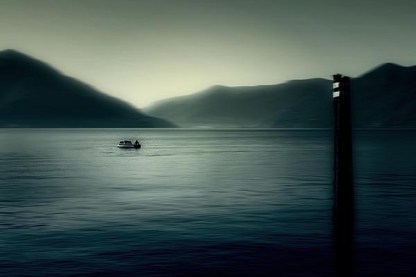 boat on the Lake Maggiore Print by Joana Kruse