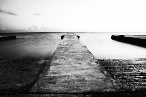 Boat Ramp And Pier Print by Charmian Vistaunet