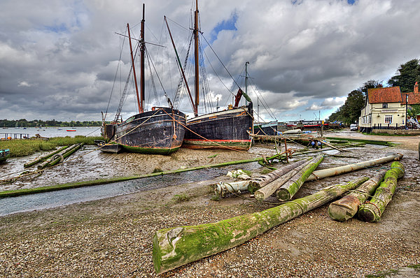 Boats And Logs At Pin Mill Print by Gary Eason
