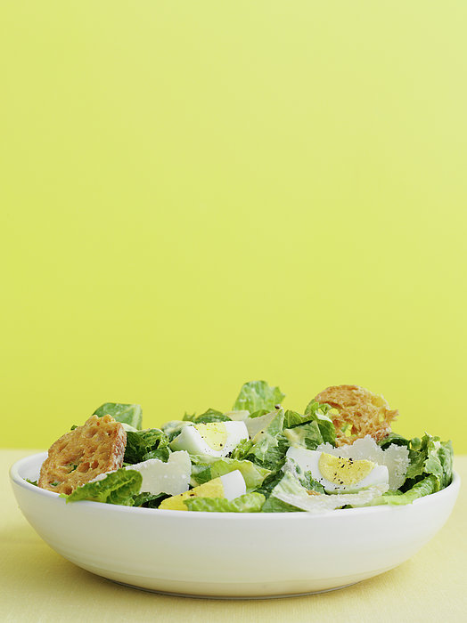 Bowl Of Caesar Salad With Egg Print by Cultura/BRETT STEVENS