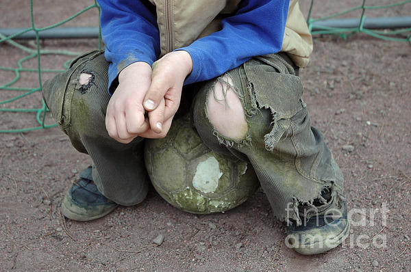 Boy Sitting On Ball - Torn Trousers Print by Matthias Hauser