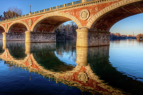 Bridge Reflection On River Print by Andrea Mucelli
