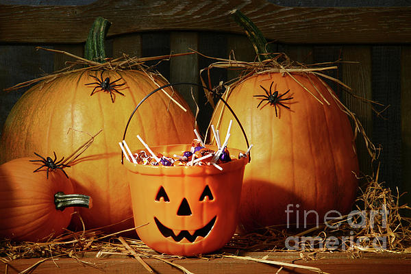 Bucket Filled With Halloween Candy Print by Sandra Cunningham